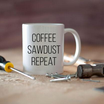 Mug with coffee sawdust repeat on workbench