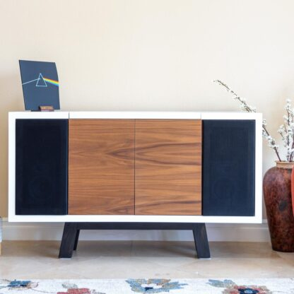 Brown and white record player cabinet with black feet in a room